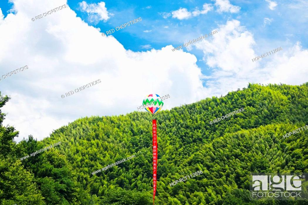 Stock Photo: Chinese lantern over trees, Emerald Valley, Huangshan, Anhui Province, China.