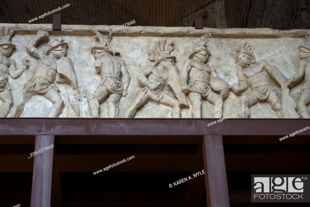 Stock Photo: frieze from Colosseum on display inside, showing multiple gladiators - Rome, Italy.