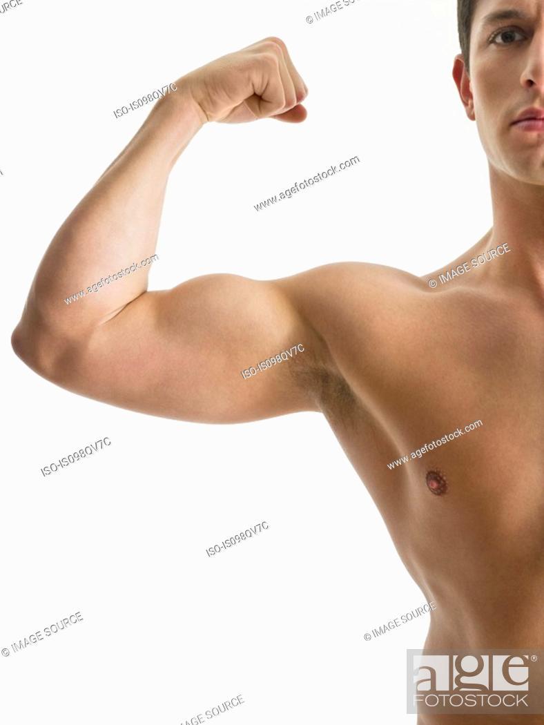 Stock Photo: Man flexing muscles.