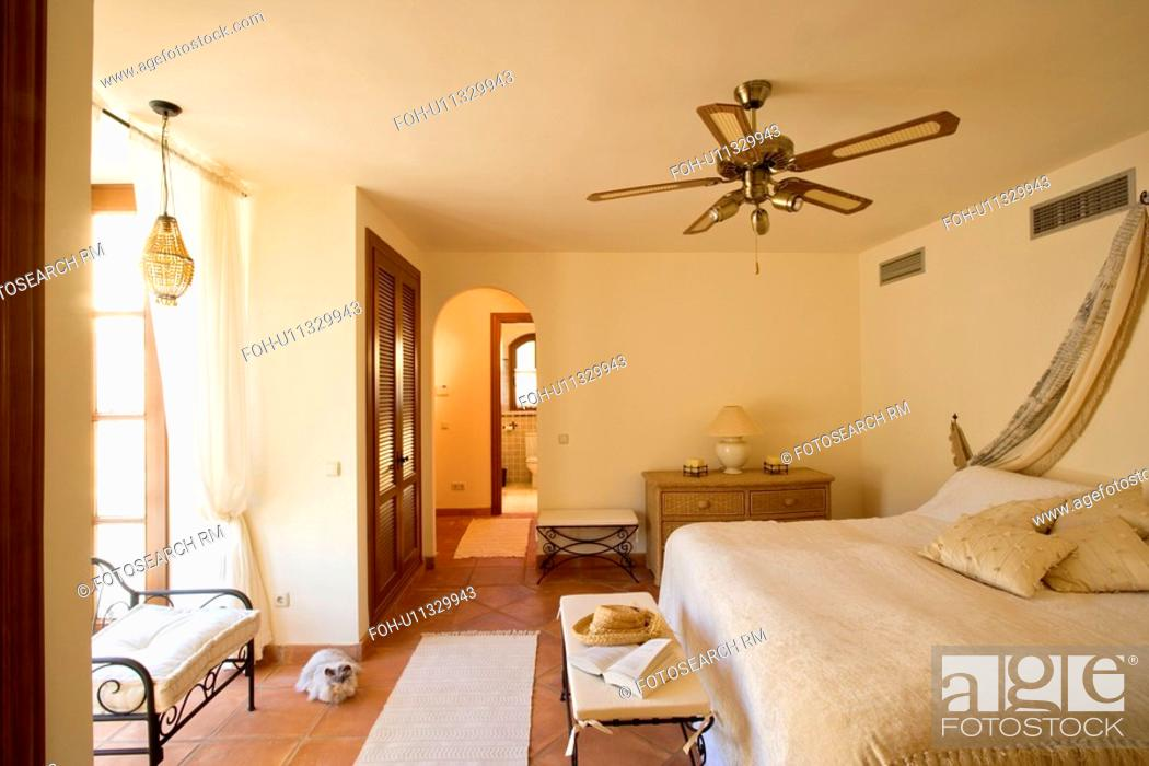Ceiling Fan Above Bed With Cream