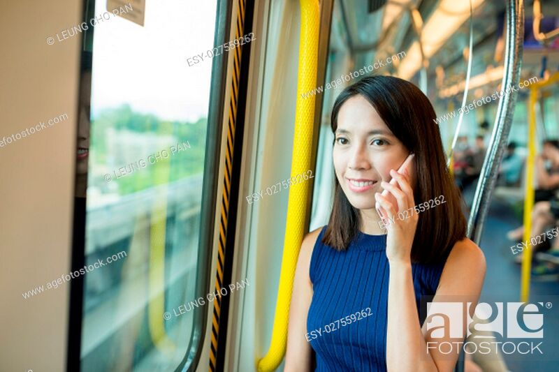 Stock Photo: Woman talk to mobile phone in train.