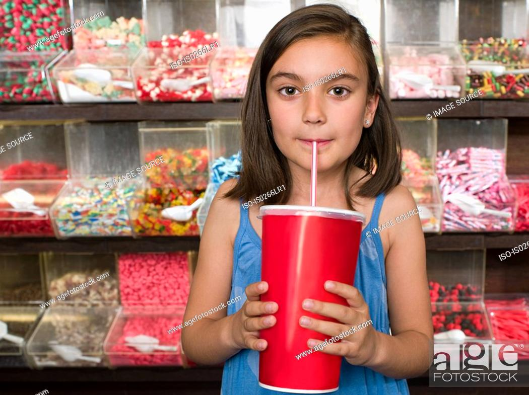 Stock Photo: A girl drinking a soft drink.