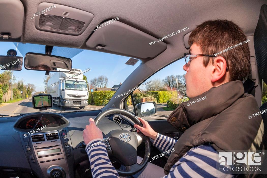 Stock Photo: 17 year old boy learning to drive in the Uk.
