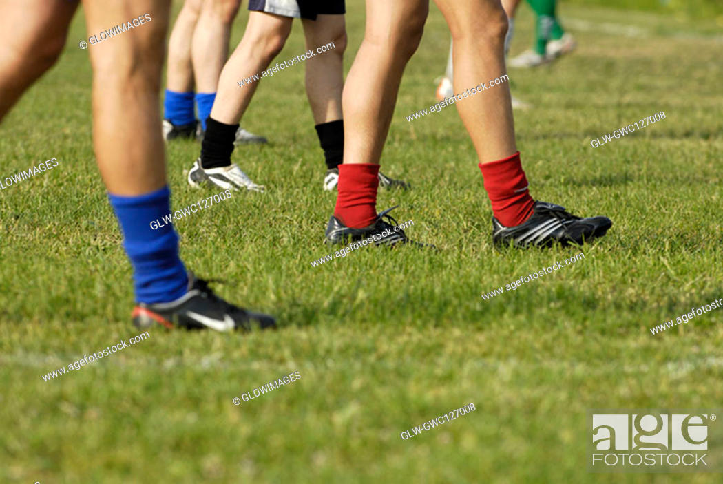 Stock Photo: Low section view of a group of soccer players walking on a soccer field.