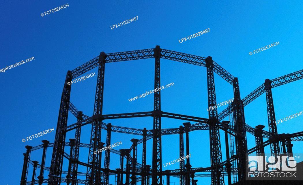 Stock Photo: Silhouette view of Victorian gasholders, London, UK.