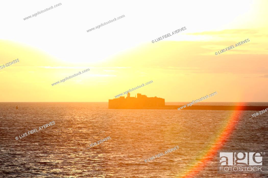 Stock Photo: Sunset at the output of the industrial port of Cherbourg in France.