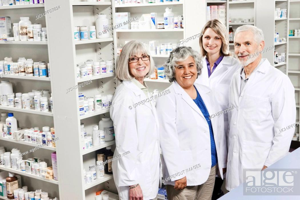 Stock Photo: Portrait of four smiling pharmacists.