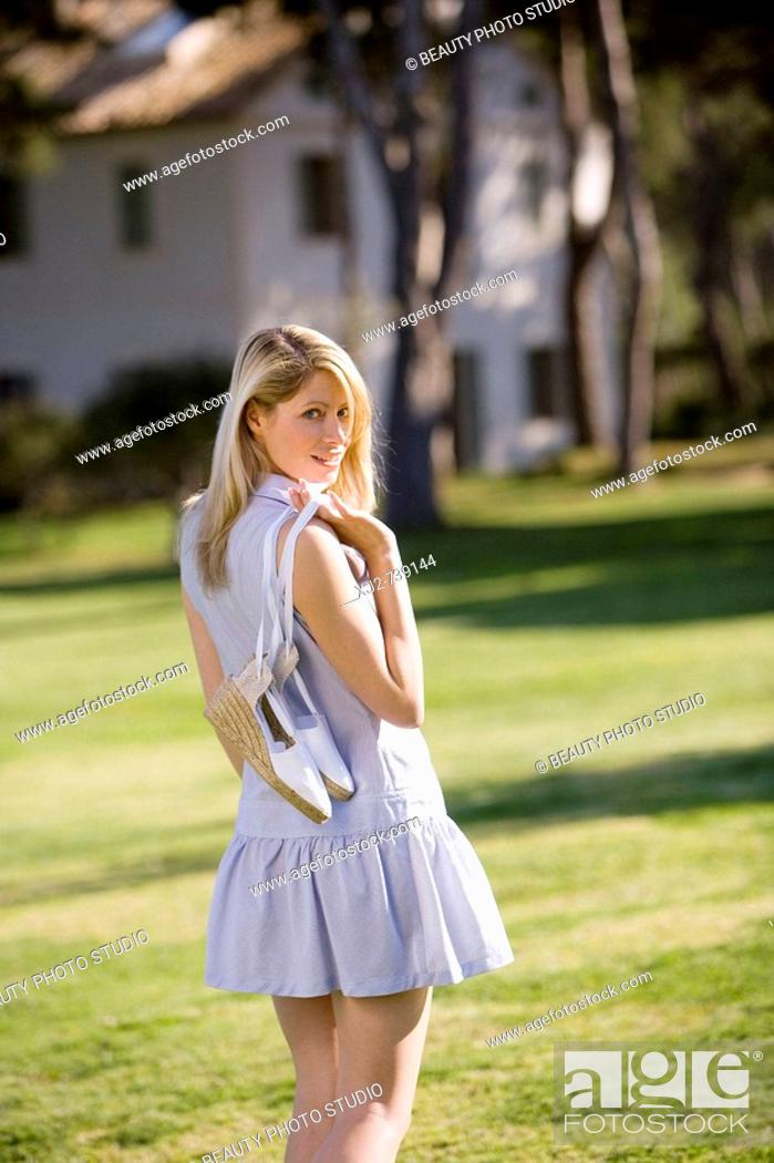 Stock Photo: Woman going for a walk in the country.
