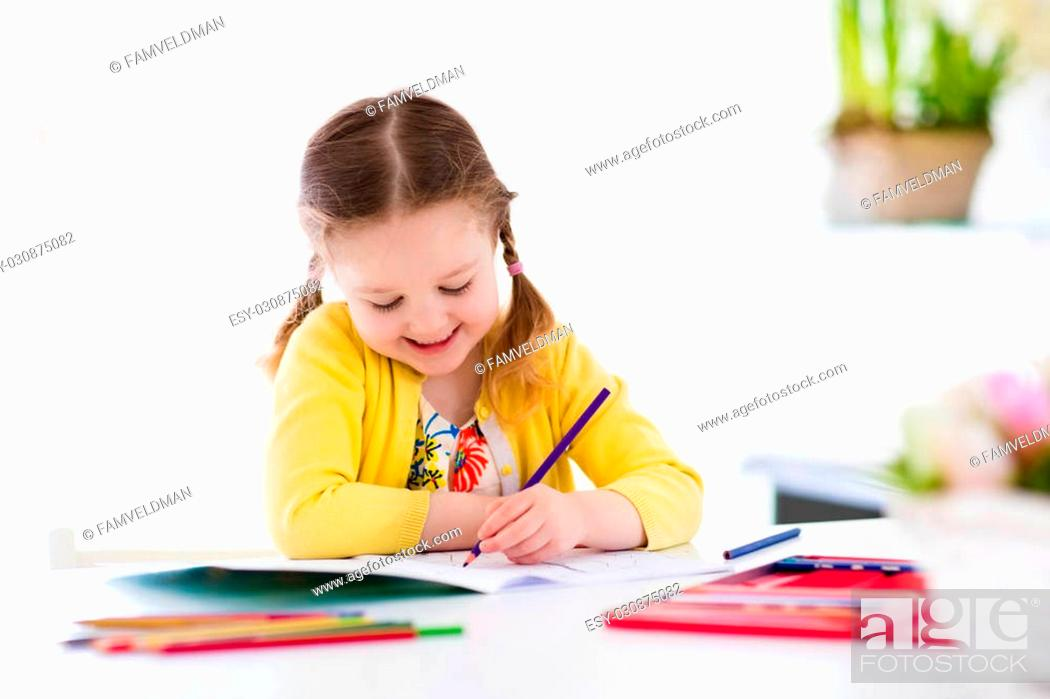 Cute Little Girl Doing Homework Reading A Book Coloring Pages Writing And Painting Stock Photo Picture And Low Budget Royalty Free Image Pic Esy 030875082 Agefotostock