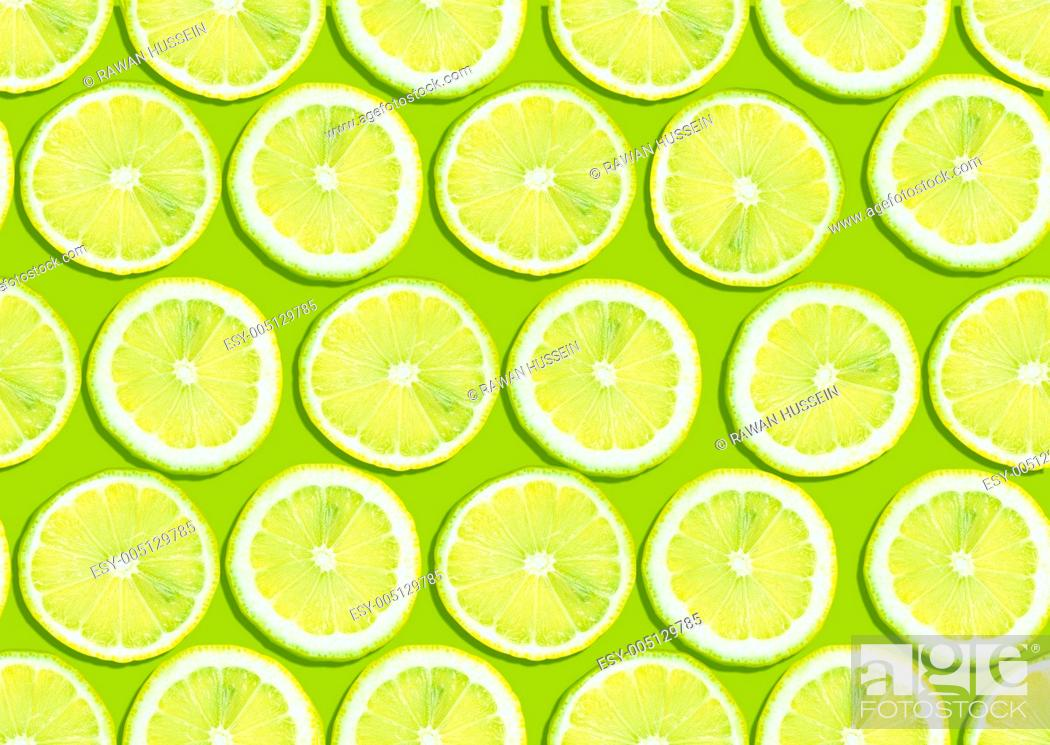 Stock Photo: seamless background of fresh lemon slices.