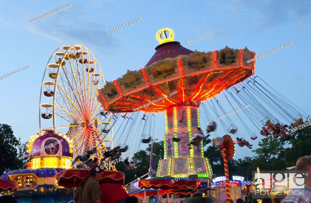 Stock Photo: Swing caroussel and Ferris wheel at the Dult fun fair, Landshut, Bavaria, Germany, Europe.