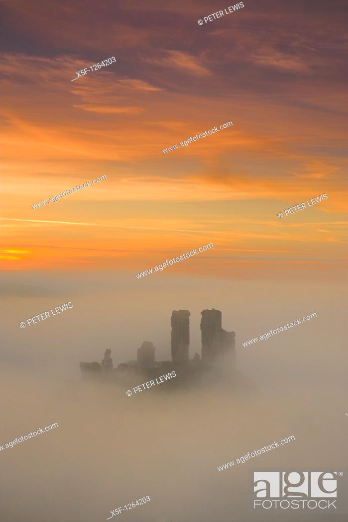 Stock Photo: Corfe Castle in the mist at Dawn Purbeck Dorset.