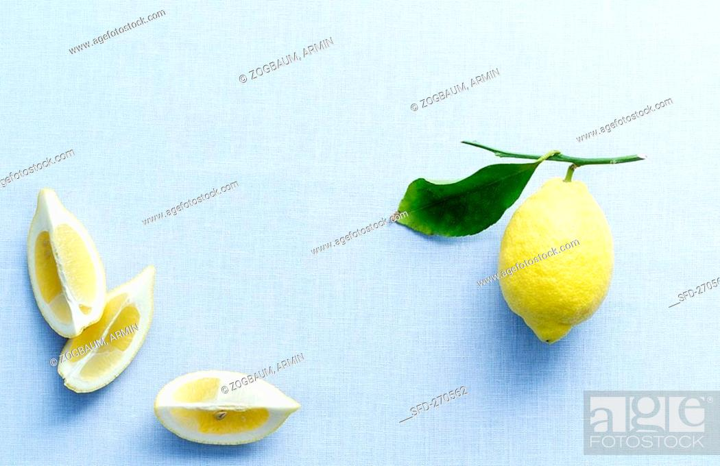 Stock Photo: Lemon wedges and lemon with leaf.