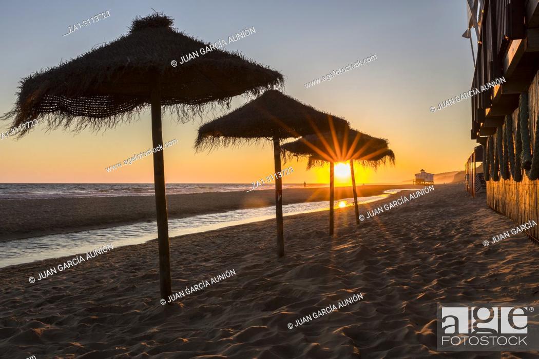 Stock Photo: Sunset landscape at spanish coast beach. Costa de la Luz seashore, Matalascanas, Huelva.