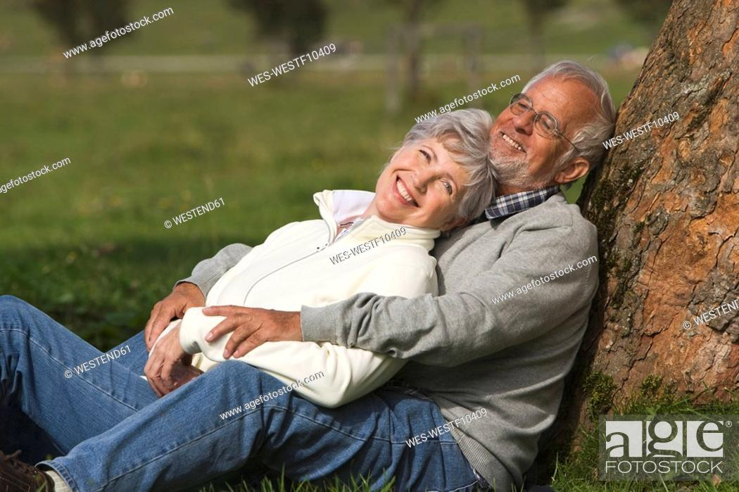 Stock Photo: Austria, Karwendel, Senior couple in the countryside, embracing.