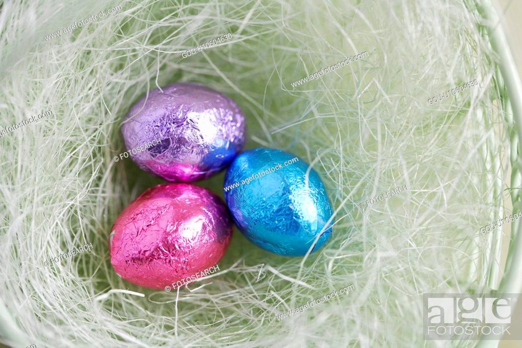 Stock Photo: Three Easter egg candies in bowl (close-up, directly above).
