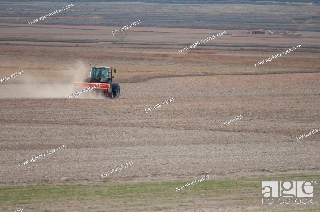 Stock Photo: Gallocanta Lagoon Natural Reserve. Aragon. Spain. November 24, 2009: tractor plowing a field.