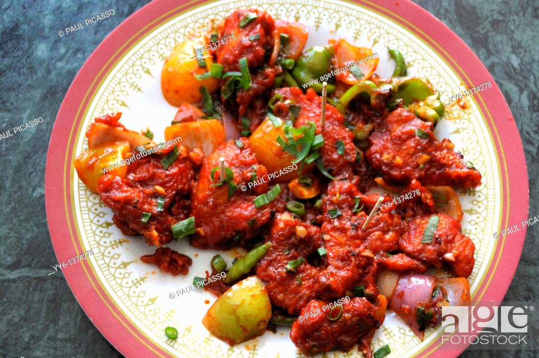 Stock Photo: Nepal food , Chicken chilli or indian chilli chicken nepalese style in a sticky pepper sweet and chilli marinate.