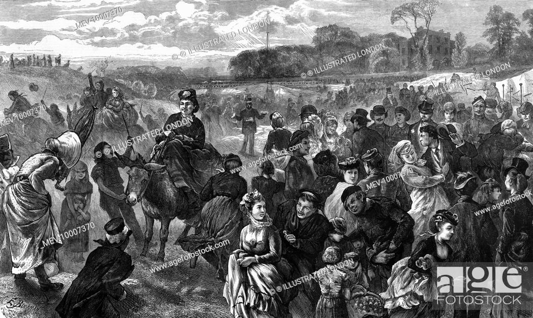 Stock Photo: Holidaymakers making merry on Hampstead Heath, north west London.