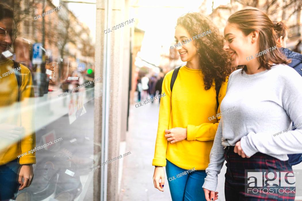 Stock Photo: Girlfriends window shopping in city.