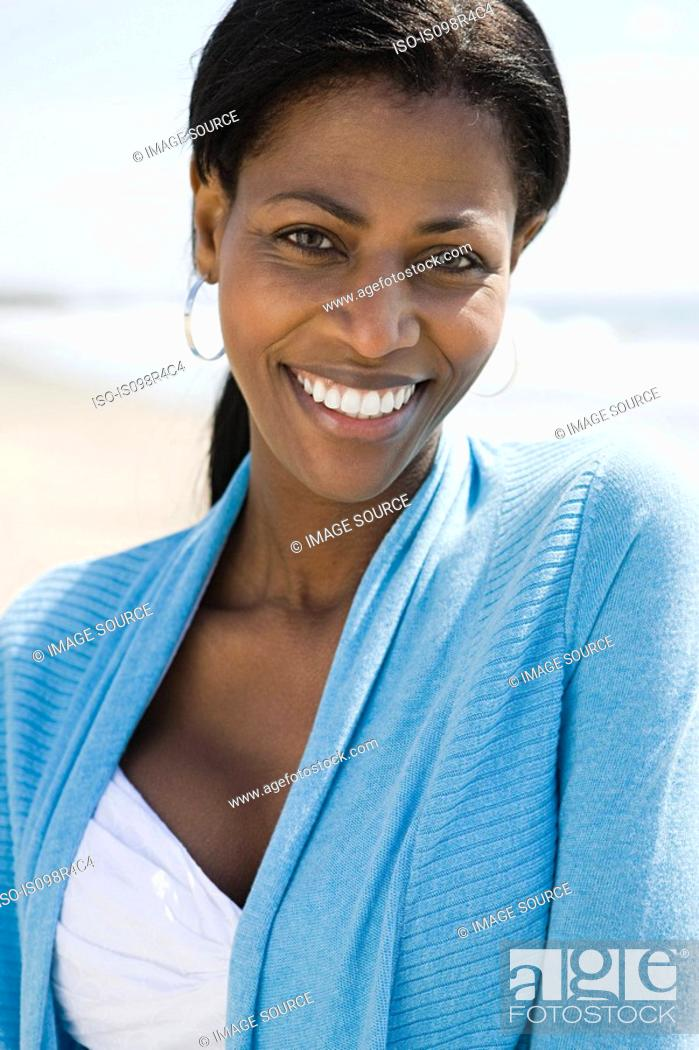 Stock Photo: Smiling woman on a beach.