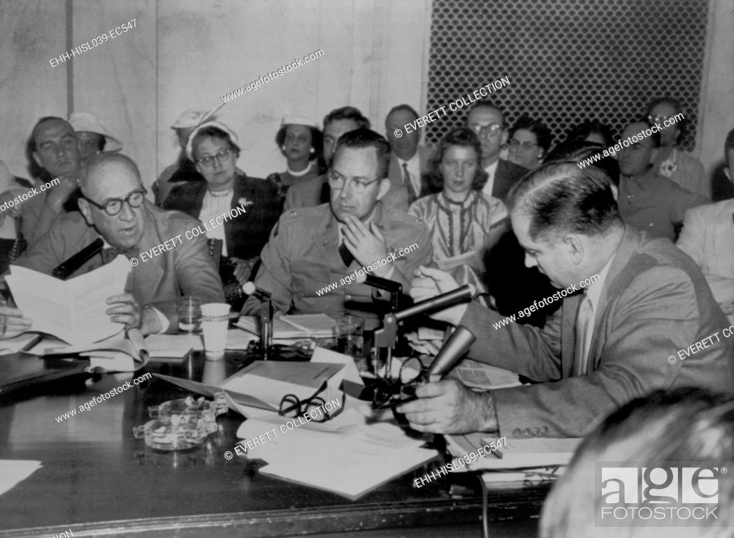 Stock Photo: Senator Joseph McCarthy (right) demands an apology from Army Counsel Joseph Welch (left). June 15, 1954. In between them is Lt. Col. John F. T.