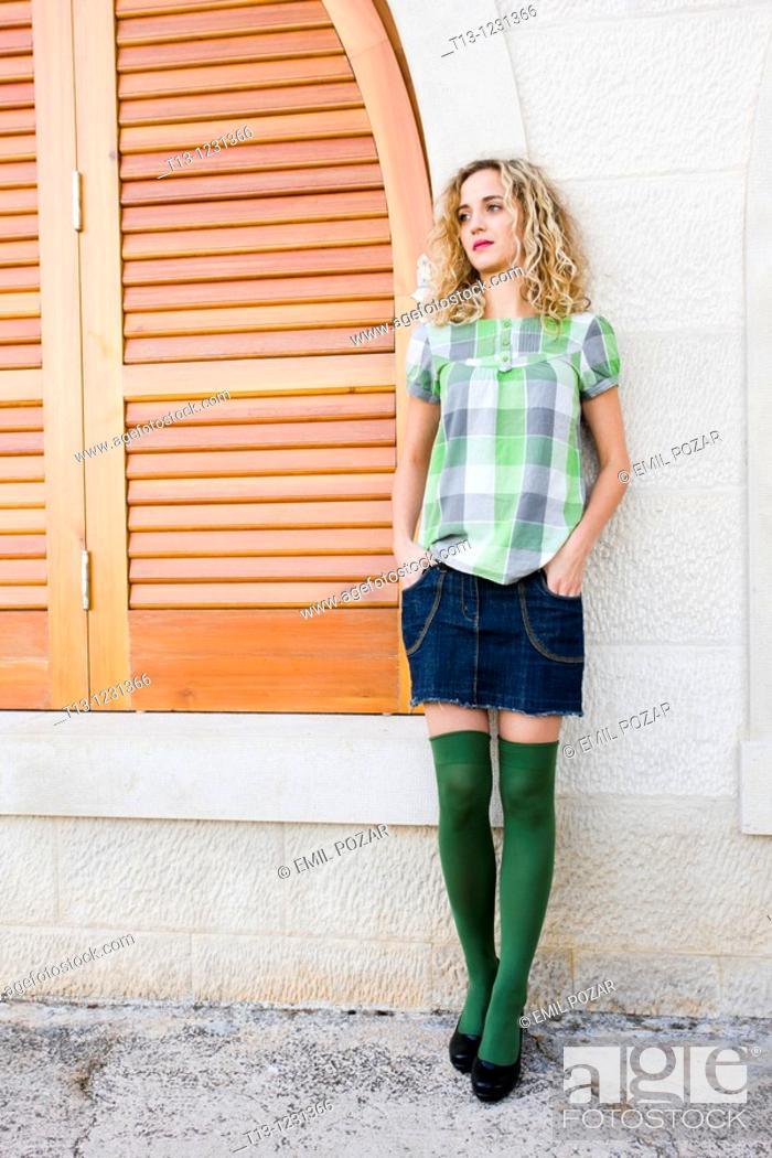 Stock Photo: Daydreaming young woman.