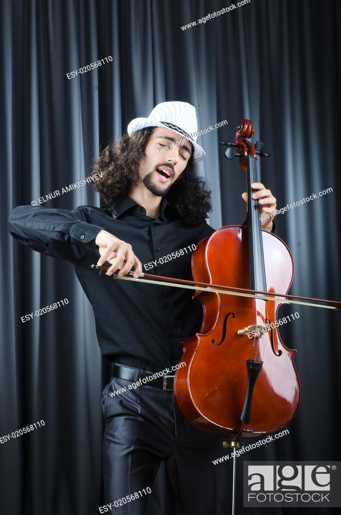 Stock Photo: Man playing the cello.