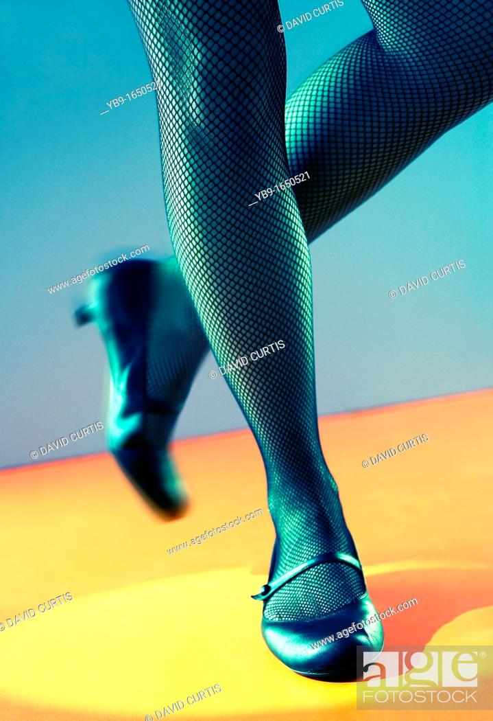Stock Photo: Close up of a tap dancer's legs.