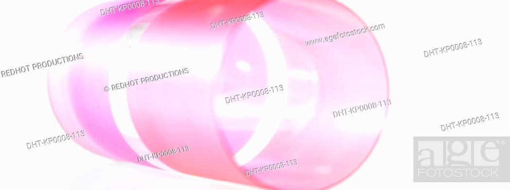 Stock Photo: Pink Plastic Cup lying on side.