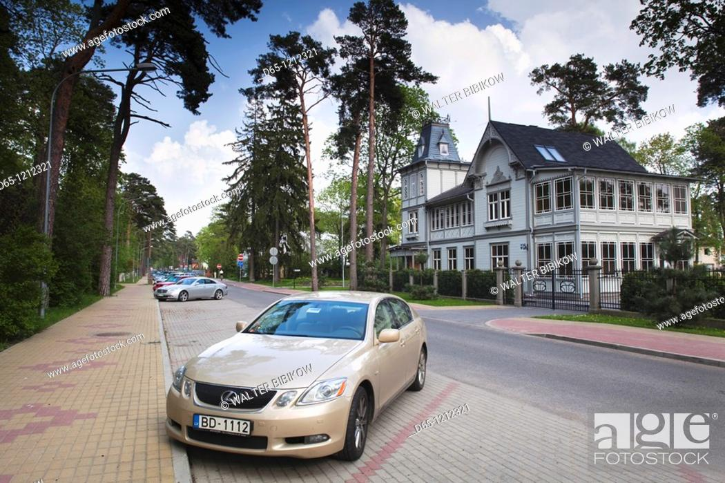 Stock Photo: Latvia, Jurmala, Majori Village, new dacha beach house and Lexus automobile.