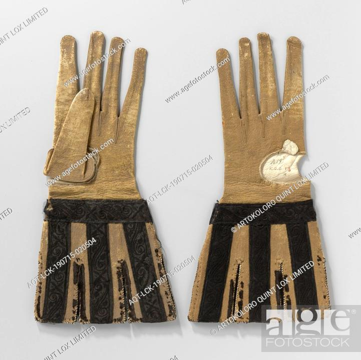 Stock Photo: Goat glove (?) Leather, ocher colored with incised, loose caps decorated with black satin ribbon embroidered with a black silk floral pattern.