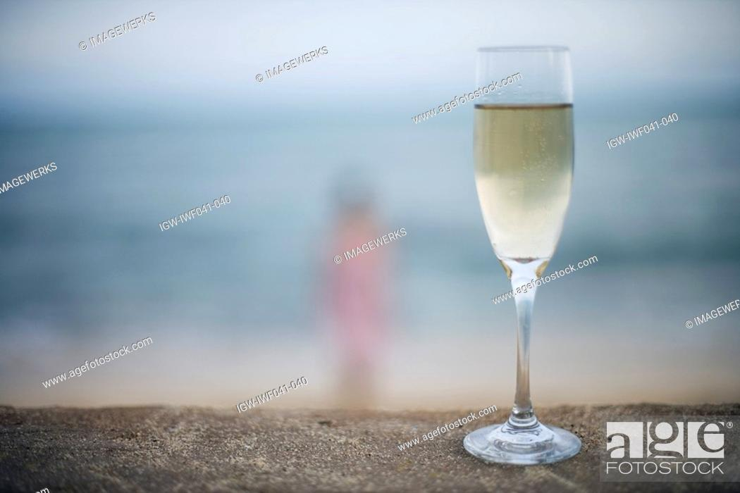 Stock Photo: Close-up of wineglass filled with alcoholic beverage.