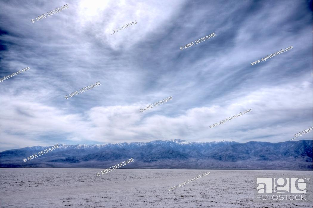 Stock Photo: Salt Flats in Bad Water Basin in Death Valley under heavy cloud cover that seems to look other worldly.