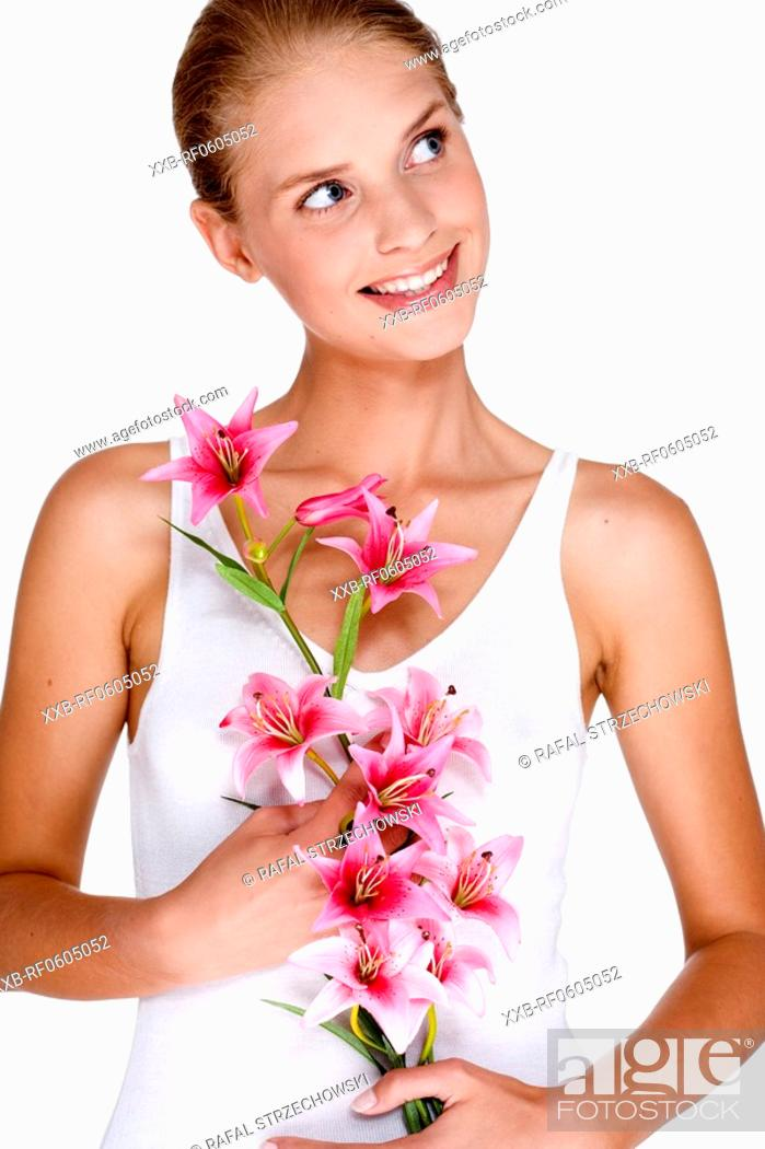 Stock Photo: smilling woman with orchid.