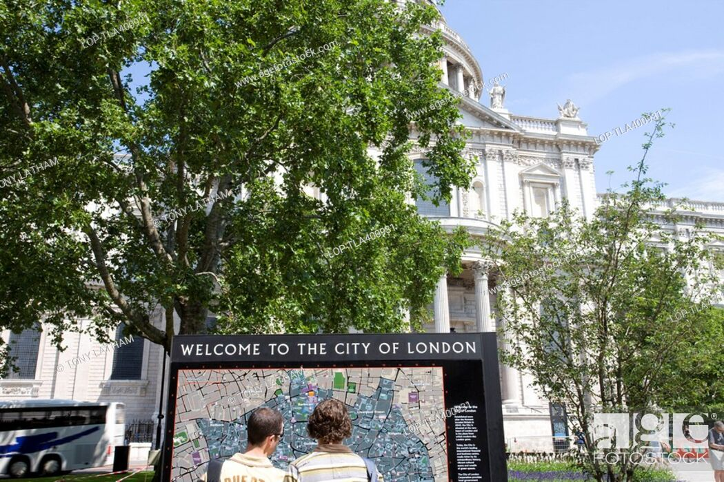 London City Tourist Map.England London City Of London Tourists Examining A Street Map