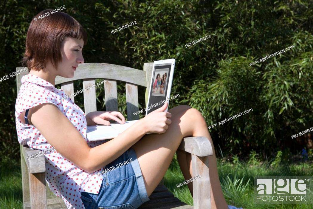 Stock Photo: Teenage girl using laptop.