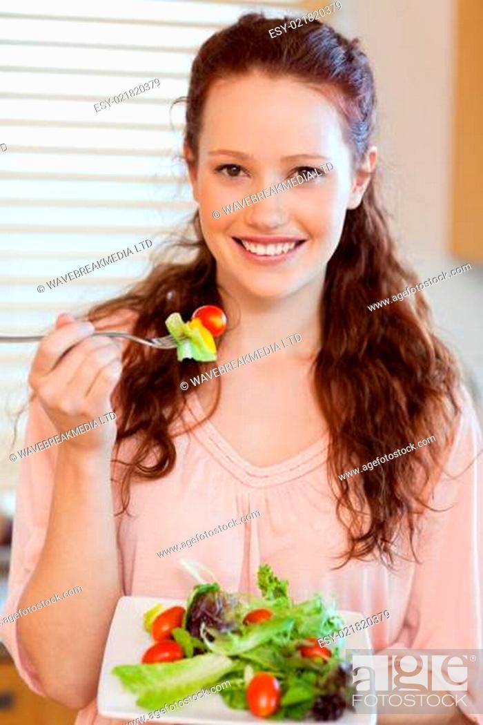 Stock Photo: Girl eating salad.
