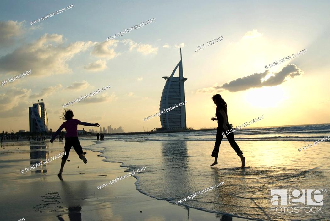 Stock Photo: Mother and daughter on the beach in Dubai, UAE.