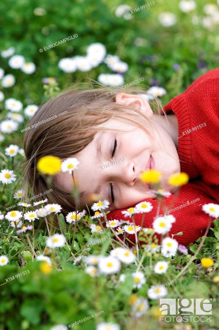 Stock Photo: Little girl sleeping in meadow.