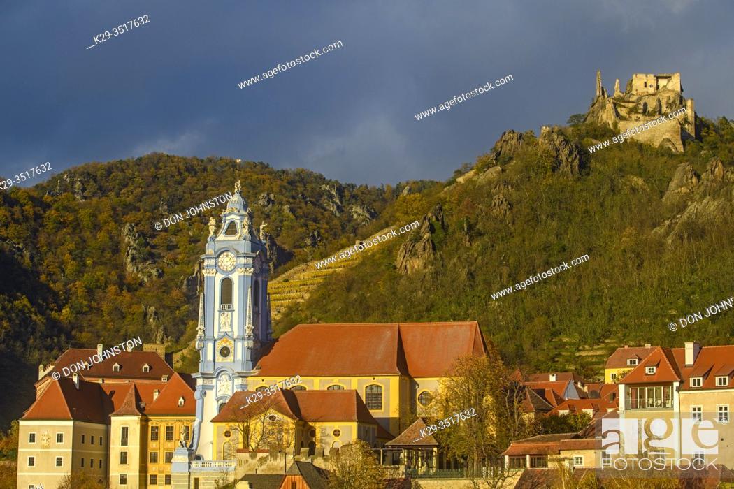 Stock Photo: Autumn in the Wachau Valley- Durnstein parish church with distant Durnstein Castle on the banks of the Danube, Durnstein, Lower Austria, Austria.