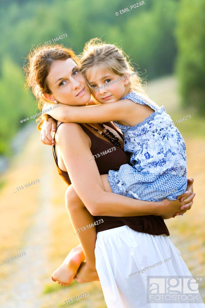 Stock Photo: Mother and daughter outdoors.