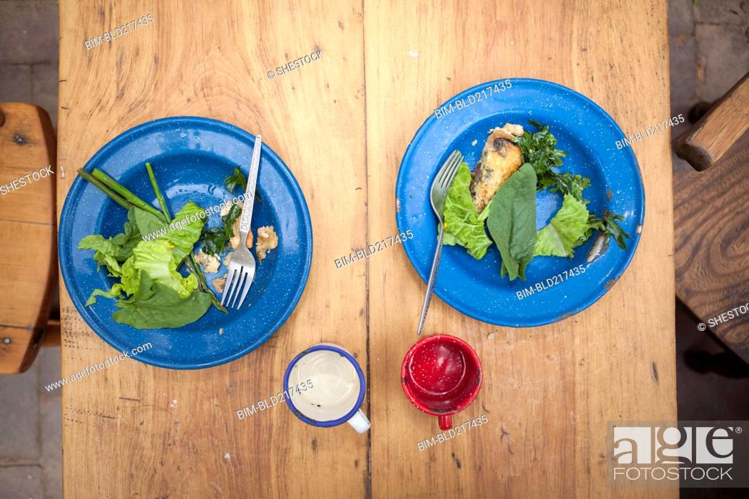Stock Photo: High angle view of plates of greens on table.
