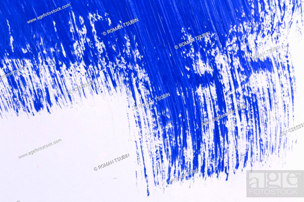 Stock Photo: blue stroke of the paint brush on white paper.