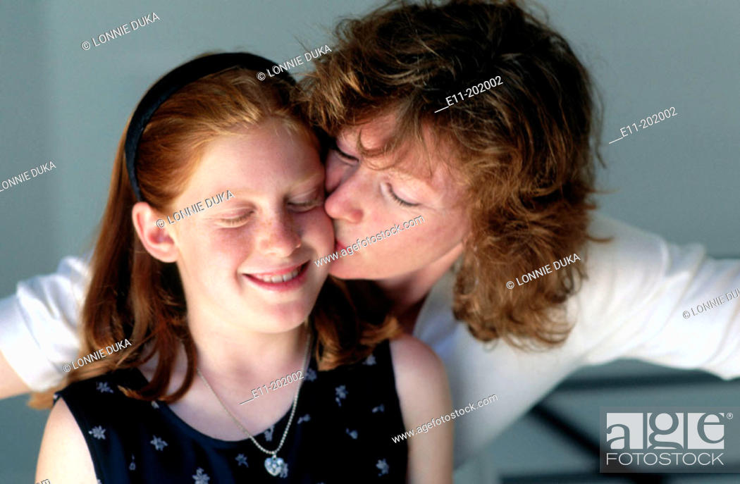 Stock Photo: Portrait of mother kissing daughter.