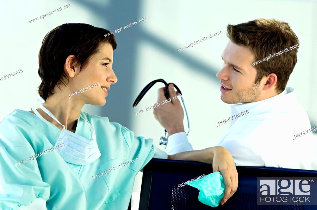 Stock Photo: Female doctor discussing with a male doctor.