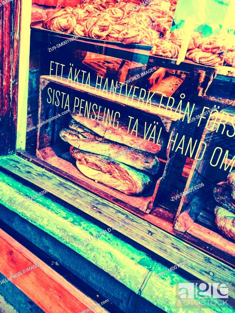 Stock Photo: Bread and cinnamon buns displayed in bakery window, Gamla Stan, Stockholm, Sweden, Scandinavia.