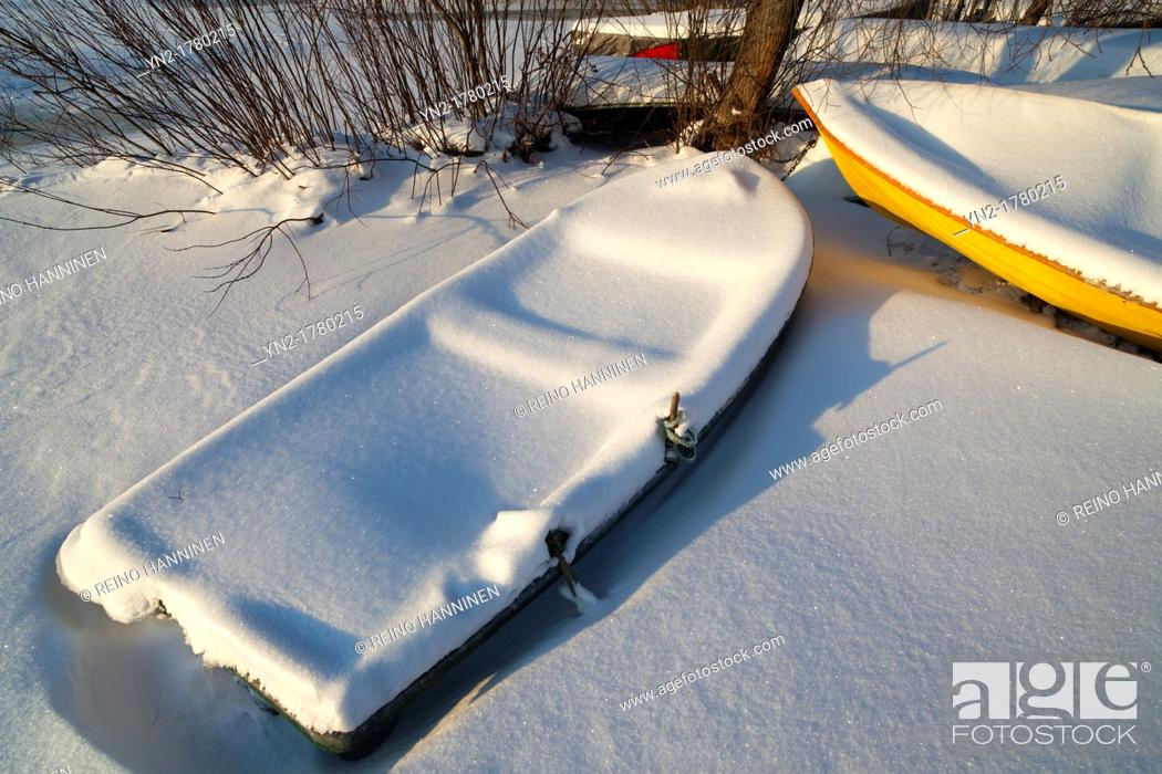 Stock Photo: Rowboat filled with snow and stuck into ice  Location Oulu Finland Scandinavia Europe.
