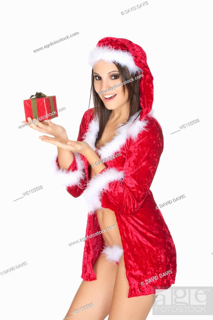 Stock Photo: A very beautiful and sexy woman dresses as a sexy santa.