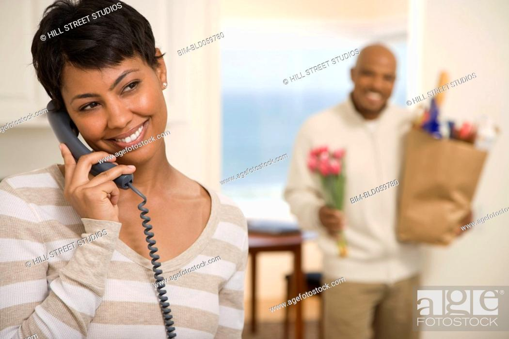 Stock Photo: African woman talking on telephone.